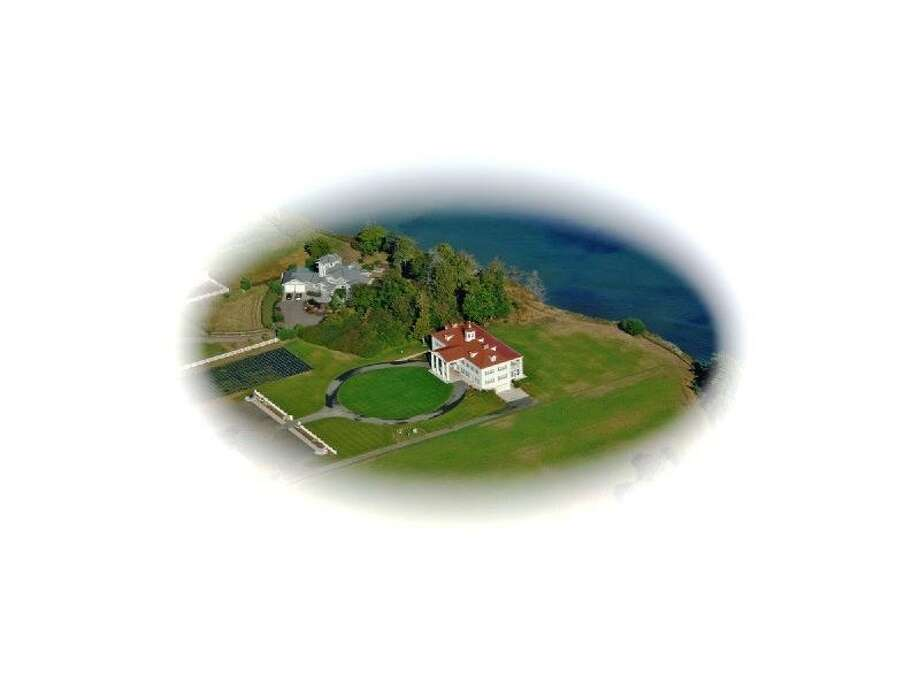Aerial view of the George Washington Inn, at 939 Finn Hall Road, in Port Angeles. The 10,000-square-foot bed and breakfast, built in 2002, has eight bedrooms, eight bathrooms, a theater, decks, patios, a geothermal heating system, water and mountain views, outbuildings and a helipad on an 11-acre lavender farm along the Strait of Juan de Fuca. It's listed for $3 million. Photo: Courtesy Sam Cunningham, Sandy Justen And Julie Biniasz, Realogics Sotheby's International Realty