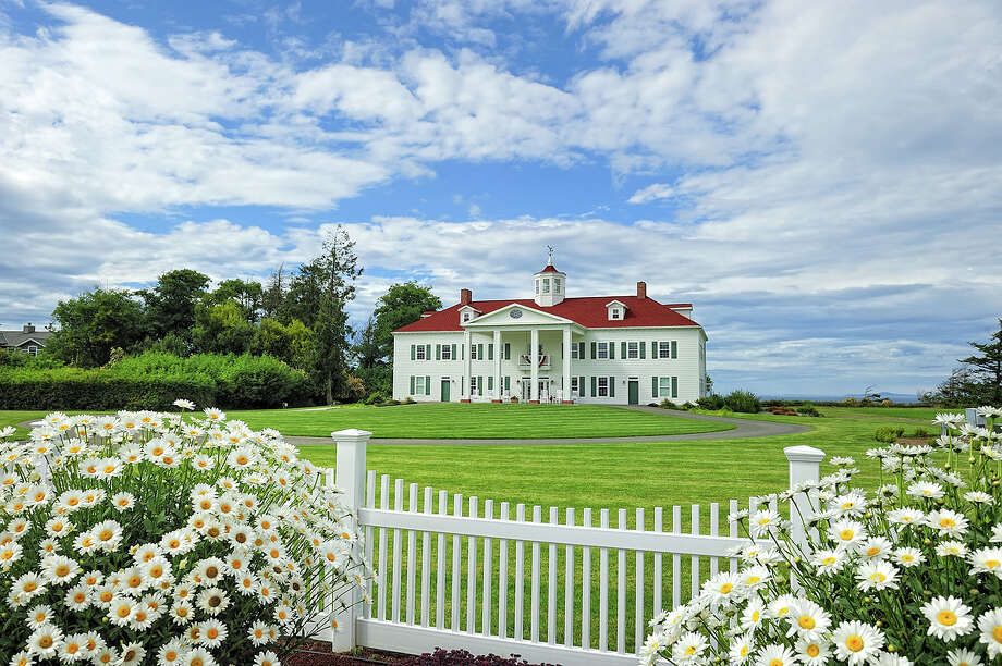 View of the George Washington Inn, at 939 Finn Hall Road, in Port Angeles. The 10,000-square-foot bed and breakfast, built in 2002, has eight bedrooms, eight bathrooms, a theater, decks, patios, a geothermal heating system, water and mountain views, outbuildings and a helipad on an 11-acre lavender farm along the Strait of Juan de Fuca. It's listed for $3 million. Photo: Courtesy Sam Cunningham, Sandy Justen And Julie Biniasz, Realogics Sotheby's International Realty
