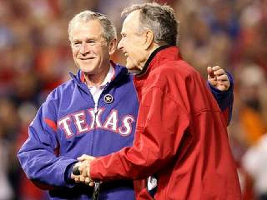 George W. Bush with George H.W. Bush. Getty Images.