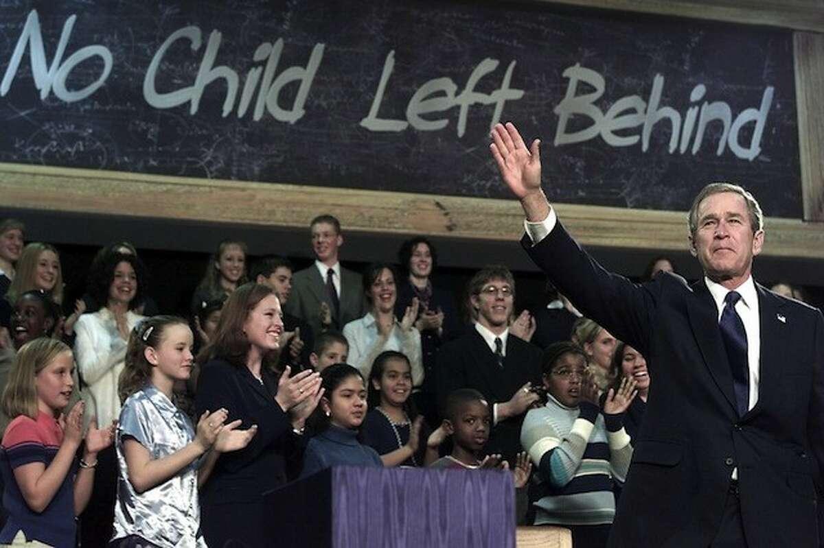 George W. Bush signs