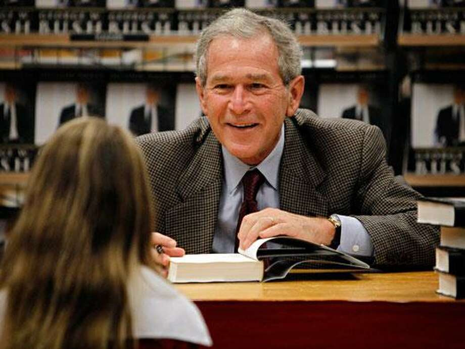 "George W. Bush at a signing of his book, ""Decision Points."""