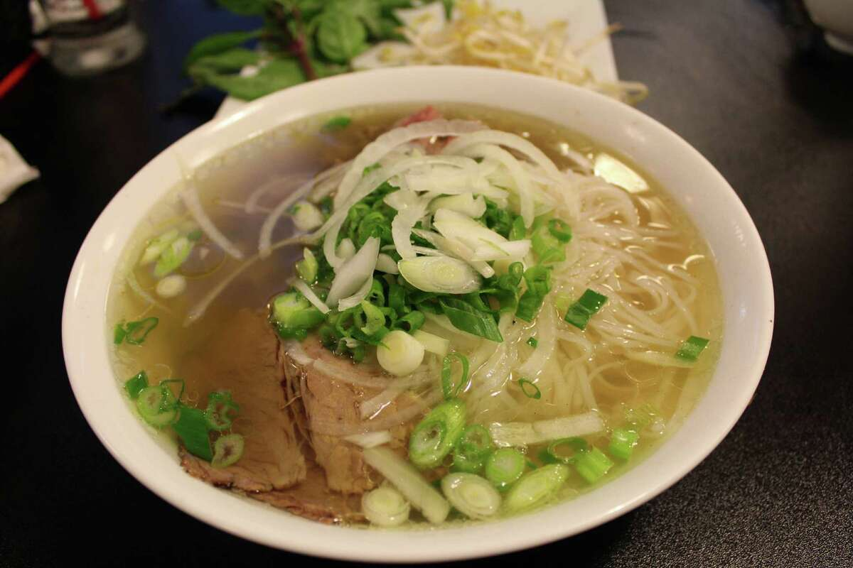 Pho Tài Nám Gan (or noodle soup with beef eye round, brisket and tendon) has a rich and flavor-packed broth.