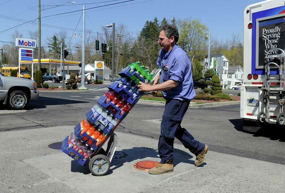 Robert Rumble, a driver with the Pepsi Beverage Co., makes a delivery at the Mobil Station on Route 7 at the Four Corners in Brookfield, Conn, Wednesday, April 24, 2013. Photo: Carol Kaliff / The News-Times