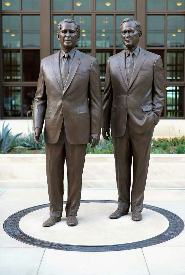 Statues of former Presidents George W. Bush (L) and his father George H.W. Bush are on display during a tour of the George W. Bush Presidential Center on the campus of Southern Methodist University on April 24, 2013 in Dallas, Texas. Dedication of the George W. Bush Presidential Library is to take place on April 25 with all five living U.S. Presidents in attendance and an expected 8,000 invitation-only guests. Photo: Kevork Djansezian, Getty Images / 2013 Getty Images
