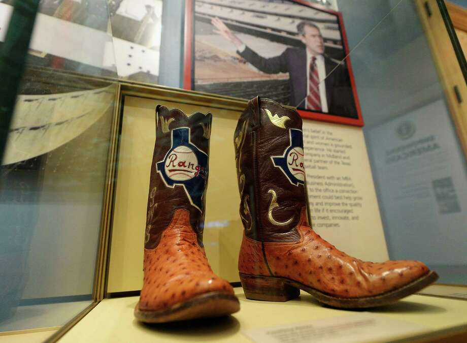 Boots commemorating George W. Bush's tenure as general managing partner of the Texas Rangers are displayed at the George W. Bush Presidential Center on the campus of Southern Methodist University on April 24, 2013 in Dallas, Texas. Dedication of the George W. Bush Presidential Library is to take place on April 25 with all five living U.S. Presidents in attendance and an expected 8,000 invitation-only guests. Photo: Kevork Djansezian, Getty Images / 2013 Getty Images