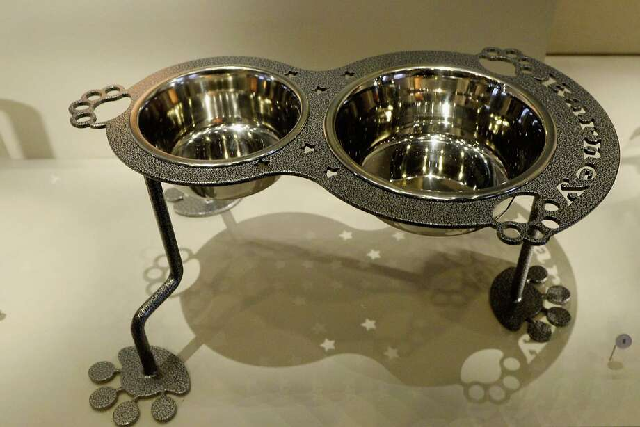 Steel dog bowls with paw shaped feet given as a gift to Presidents George W. Bush sit on display at the George W. Bush Presidential Center on the campus of Southern Methodist University on April 24, 2013 in Dallas, Texas. Dedication of the George W. Bush Presidential Library is to take place on April 25 with all five living U.S. Presidents in attendance and an expected 8,000 invitation-only guests. Photo: Kevork Djansezian, Getty Images / 2013 Getty Images