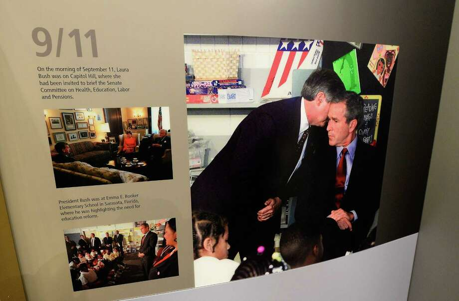 A photo from the September 11 terrorist attacks portion of the George W. Bush Presidential Center on the campus of Southern Methodist University is displayed on April 24, 2013 in Dallas, Texas. Dedication of the George W. Bush Presidential Library is to take place on April 25 with all five living U.S. Presidents in attendance and an expected 8,000 invitation-only guests. Photo: Kevork Djansezian, Getty Images / 2013 Getty Images