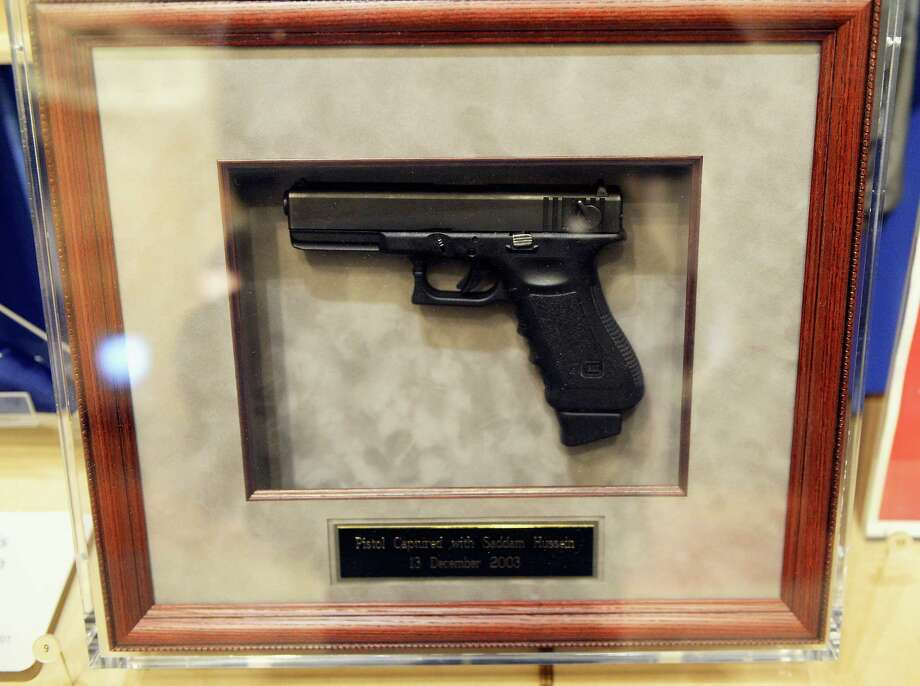 A pistol captured with Saddam Hussein on December, 13, 2003, is displayed during a tour of the George W. Bush Presidential Center on the campus of Southern Methodist University on April 24, 2013 in Dallas, Texas. Dedication of the George W. Bush Presidential Library is to take place on April 25 with all five living U.S. Presidents in attendance and an expected 8,000 invitation-only guests. Photo: Kevork Djansezian, Getty Images / 2013 Getty Images