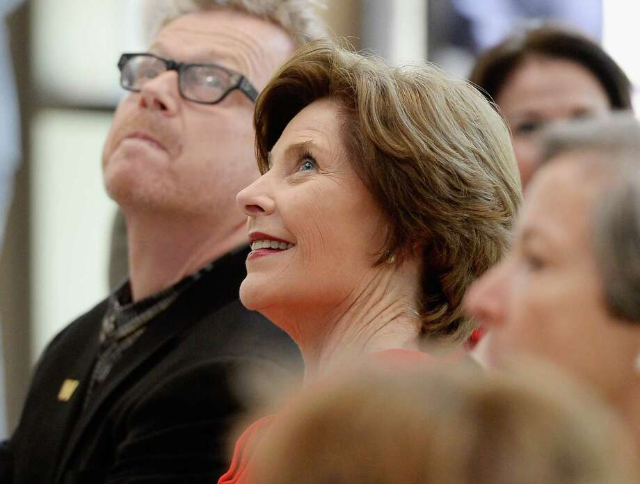 Former first lady Laura Bush looks at the 360-degree LED high definition video wall inside the Freedom Hall during signing ceremony for the joint use agreement between the National Archive and the George W. Bush Presidential Center on the campus of Southern Methodist University on April 24, 2013 in Dallas, Texas. The video wall orients visitors to the museum's permanent and temporary exhibits. Dedication of the George W. Bush Presidential Library is to take place on April 25 with all five living U.S. Presidents in attendance. Photo: Kevork Djansezian, Getty Images / 2013 Getty Images