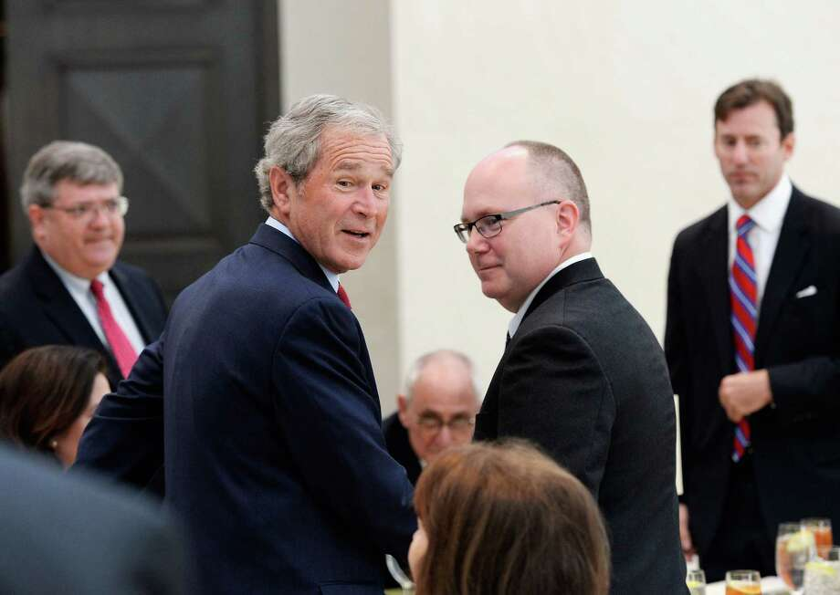 Former President George W. Bush and Alan Lowe, director of the George W. Bush Presidential Center arrive for a signing ceremony for the joint use agreement between the National Archive and the George W. Bush Presidential Center on the campus of Southern Methodist University on April 24, 2013 in Dallas, Texas. Dedication of the George W. Bush Presidential Library is to take place on April 25 with all five living U.S. Presidents in attendance. Photo: Kevork Djansezian, Getty Images / 2013 Getty Images
