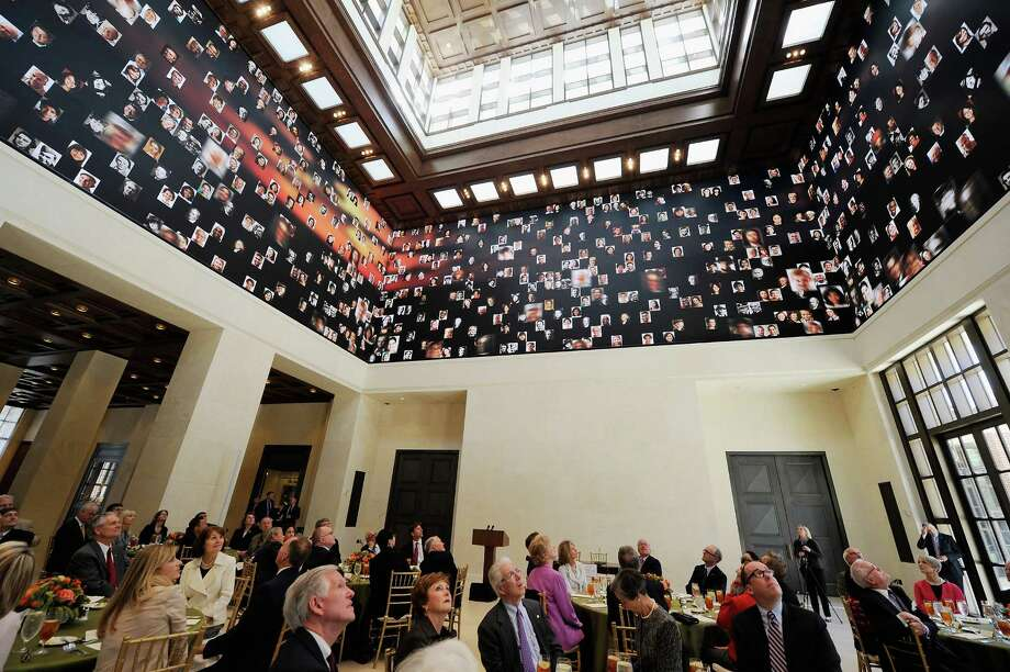 Ceremony participants look at the 360-degree LED high definition video wall inside the Freedom Hall during signing ceremony for the joint use agreement between the National Archive and the George W. Bush Presidential Center on the campus of Southern Methodist University on April 24, 2013 in Dallas, Texas. Dedication of the George W. Bush Presidential Library is to take place on April 25 with all five living U.S. Presidents in attendance. Photo: Kevork Djansezian, Getty Images / 2013 Getty Images
