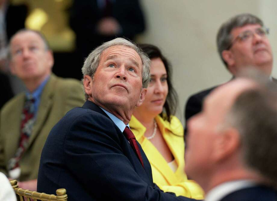 Former President George W. Bush looks at the 360-degree LED high definition video wall inside the Freedom Hall as he participates in a signing ceremony for the joint use agreement between the National Archive and the George W. Bush Presidential Center on the campus of Southern Methodist University on April 24, 2013 in Dallas, Texas. Dedication of the George W. Bush Presidential Library is to take place on April 25 with all five living U.S. Presidents in attendance. Photo: Kevork Djansezian, Getty Images / 2013 Getty Images