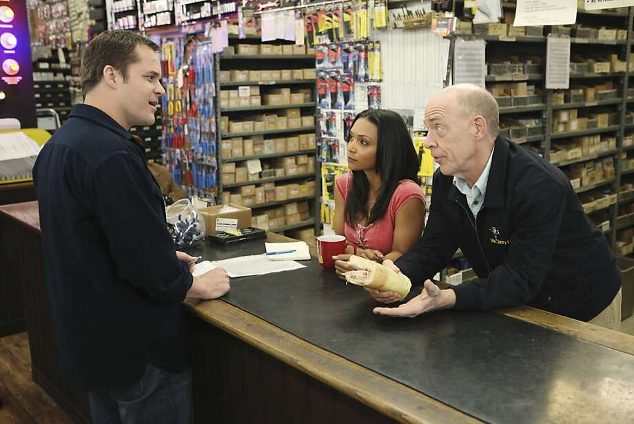 "Kyle Bornheimer (left), Danielle Nicolet and J.K. Simmons are among the stars of ""Family Tools."" Bornheimer plays Jack Shea, who returns home to run the family fix-it business. Photo: Adam Taylor, ABC"