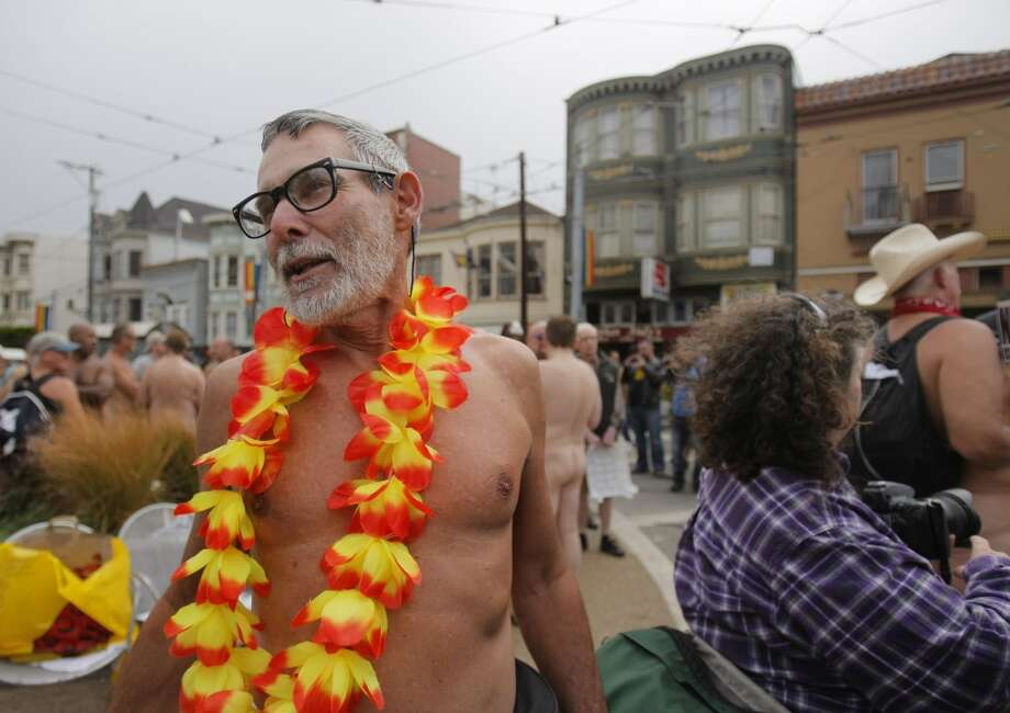 George Davis gathers with fellow nudists for a nude-in at the corner of Castro and 17th in San Francisco on Friday. Organizers say the event was planned before city Supervisor Scott Wiener mandated the use of towels if nudists wanted to sit down in public.