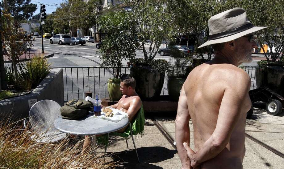 Eric Anderson, (left) and George Davis,  enjoy the weather while in the nude at a parklet on the corner of 17th street and Castro in San Francisco, Ca. , on Tuesday September 6, 2011. Since it really hasn\'t been a crime to walk around nude in the city, atEric Anderson, (left) and George Davis,  enjoy the weather while in the nude at a parklet on the corner of 17th street and Castro in San Francisco, Ca. , on Tuesday September 6, 2011. Since it really hasn\'t been a crime to walk around nude in the city, at the very least these naked folks could put a cover on chairs when they dine and put a few clothes on too, at least that\'s what Supervisor Scott Wiener is proposing with new legislation that he will introduce at the Board of Supervisors today.