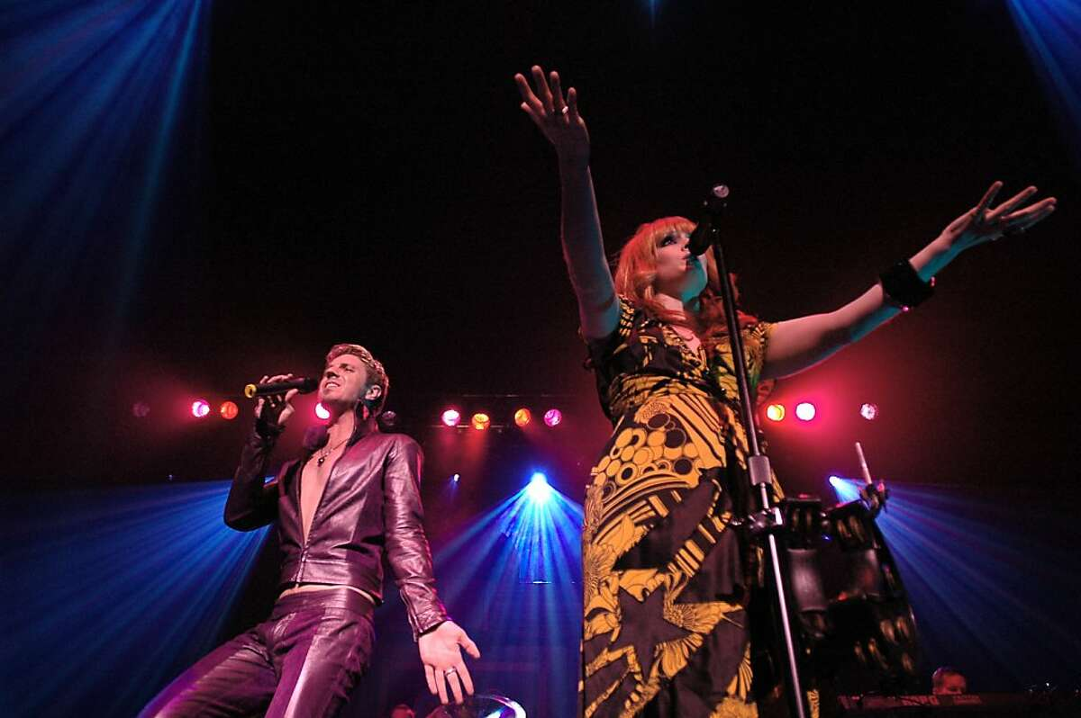 Scissor Sisters singers Jake Shears and Ana Matronic rock out during their set at the Warfield on Friday night.