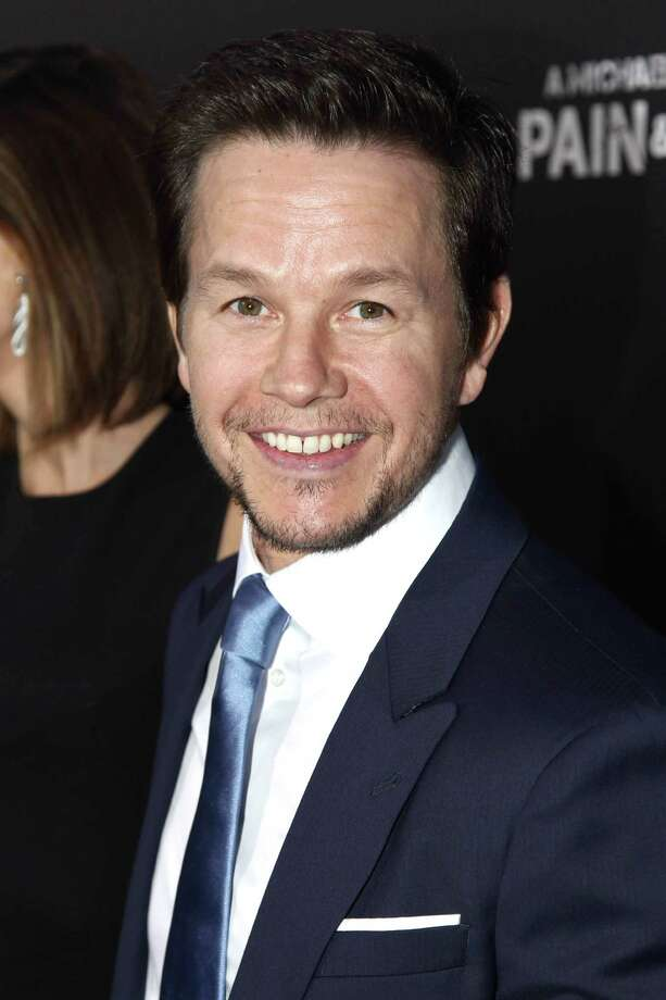 """Actor Mark Wahlberg arrives at the LA Premiere of """"Pain and Gain"""" at the TCL Theatre on Monday, April 22, 2013 in Hollywood, Calif. (Photo by Matt Sayles/Invision/AP) Photo: Matt Sayles"""