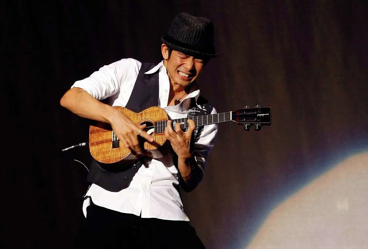LAS VEGAS - JANUARY 31: Ukulele virtuoso Jake Shimabukuro performs as a special guest of Bette Midler during the final performance of her show,
