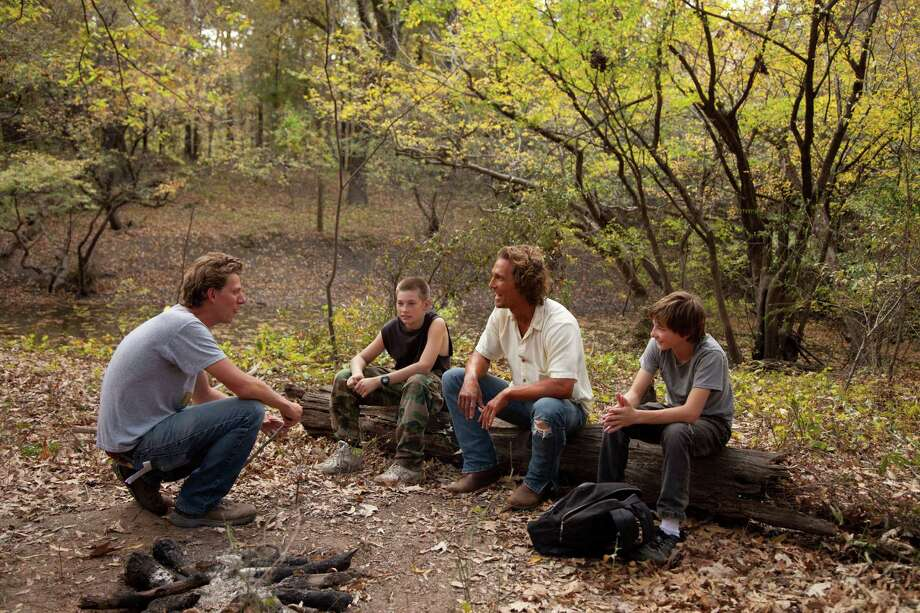 "This film publicity image released by Roadside Attractions shows director Jeff Nichols, from left, with actors, Tye Sheridan, Matthew Mc Conaughey and Jacob Lofland on the set of ""mud."" Nichols fashions a Mark Twain-esque Mississippi River tale with some big Hollywood names, including Matthew Mc Conaughey and Reese Witherspoon. (AP Photo/Roadside Attractions, Jim Bridges) Photo: Jim Bridges"