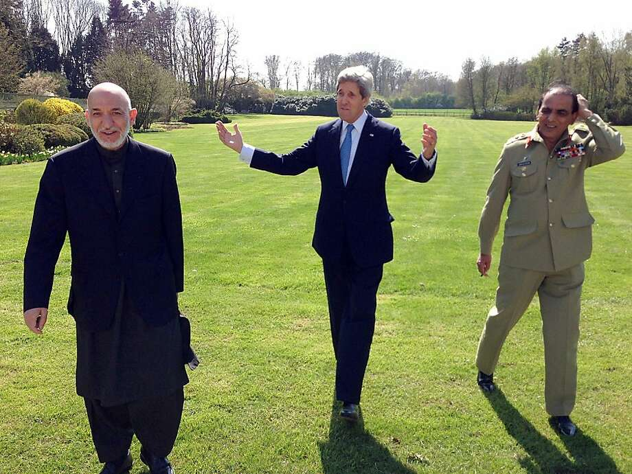 This April 24, 2013 US State Department handout image shows US Secretary of State John Kerry (C) talking with Afghan President Hamid Karzai (L) and Pakistani Army Chief-of-Staff, General Ashfaq Kayani during a break in a meeting in Brussels. The three met to discuss regional security issues, and the 2014 withdrawal of North Atlantic Treaty Organization (NATO) combat forces from Afghanistan.  Photo: Ho, AFP/Getty Images