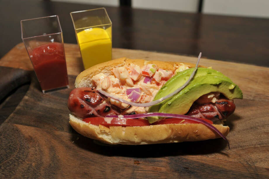 For Rockets playoff games at Toyota Center, Anthony Lopez of Levy Restaurants created the Surf 'n' Turf Steakhouse Dog: a hot dog topped with Shrimp Louie salad, avocado, tomato slices and red onions.
