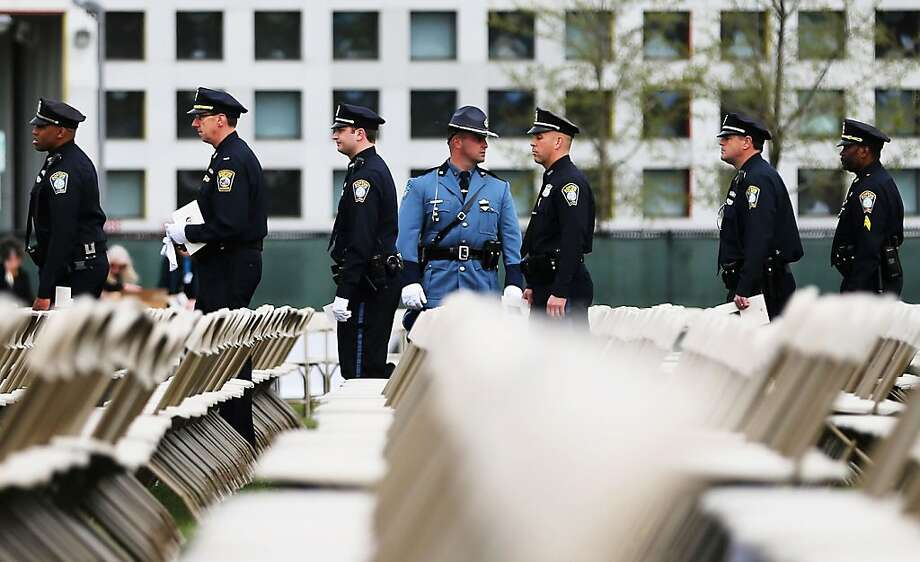Police officers arrive for the memorial service for slain Massachusetts Institute of Technology (MIT) police officer Sean Collier on April 24, 2013 in Cambridge, Massachusetts. Collier was allegedly shot by the suspects in the Boston Marathon bombing, Dzhokhar Tsarnaev, 19, and his brother Tamerlan Tsarnaev, 26, after their identities were determined and a manhunt was launched.  Tamerlan Tsarnaev was subsequently shot and killed after a car chase and shootout with police and Dzhokhar Tsarnaev was apprehended on a boat parked on a residential property in Watertown, Massachusetts. The bombing, on April 15 at the finish line of the marathon, killed three people and wounded at least 170.  Photo: Mario Tama, Getty Images