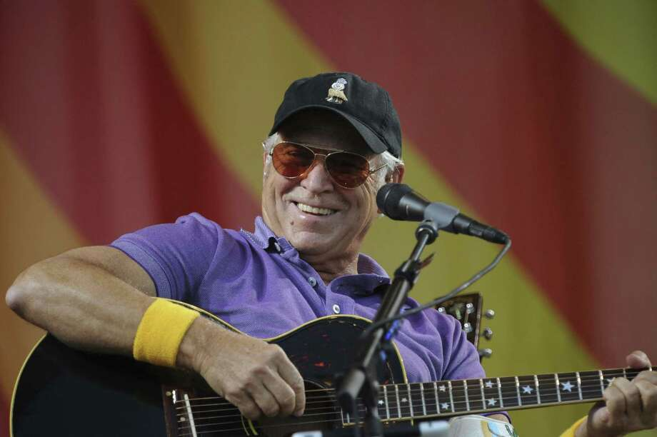 Jimmy Buffett, shown performing at the 2012 New Orleans jazz festival, comes to Austin on Thursday. Photo: Getty Images