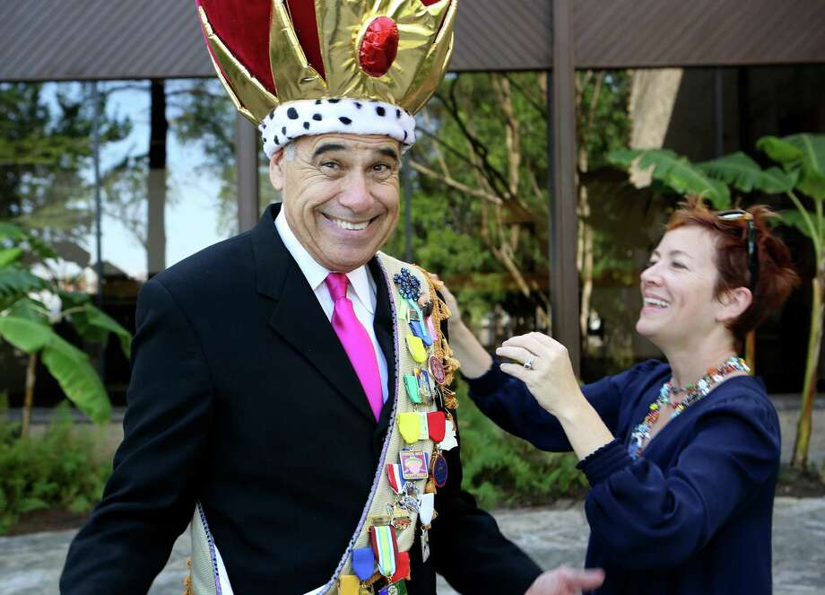 Charlie Gonzalez -- former congressman and current VIA bigwig -- is King Anchovy for Cornyation this year. Elain Wolff of PlazaDeArmas helps Gonzalez with a  crown that he will wear to various events before Cornyation. Photo: San Antonio Express-News / ©2013 San Antonio Express-News