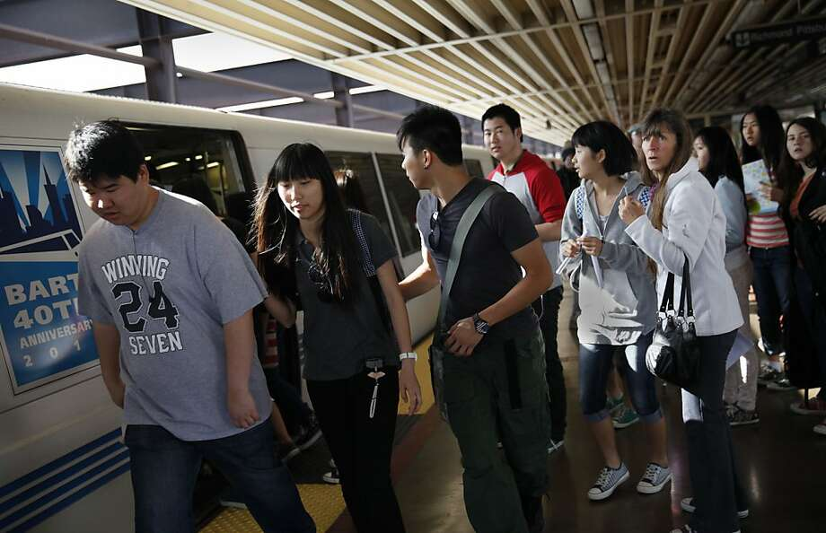 Passengers like these confronted by a crowded car in Oakland often will wait for the next train. Photo: Lea Suzuki, The Chronicle