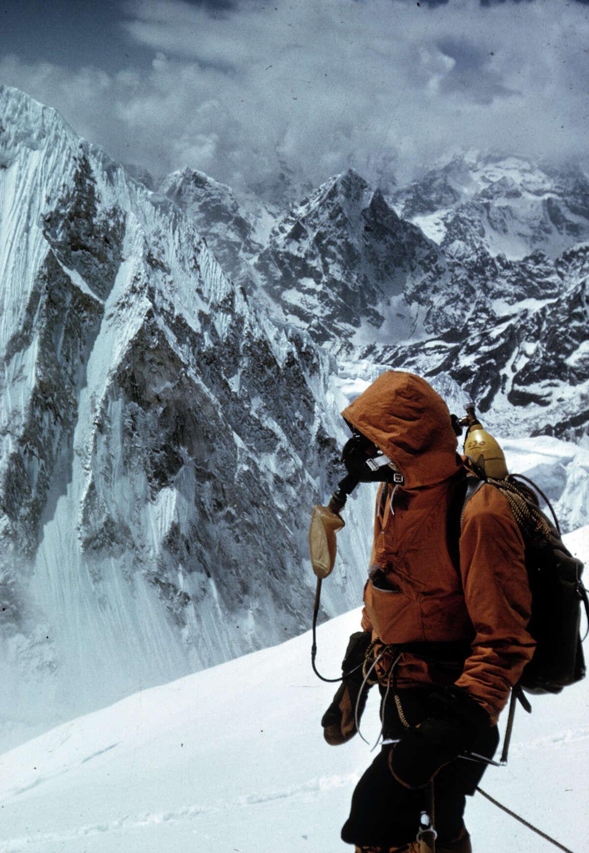 An oxygen-masked Tom Hornbein on the West Shoulder of Mt. Everest.