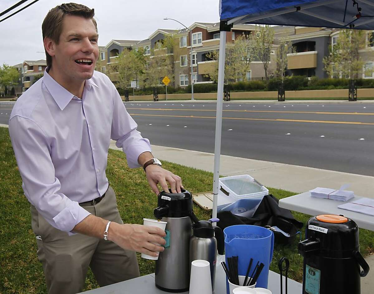 Rep. Eric Swalwell, a former waiter, pours coffee for a constituent of his congressional district in front of Denica's Pastry Cafe in Dublin, Calif. on Saturday, March 30, 2013.