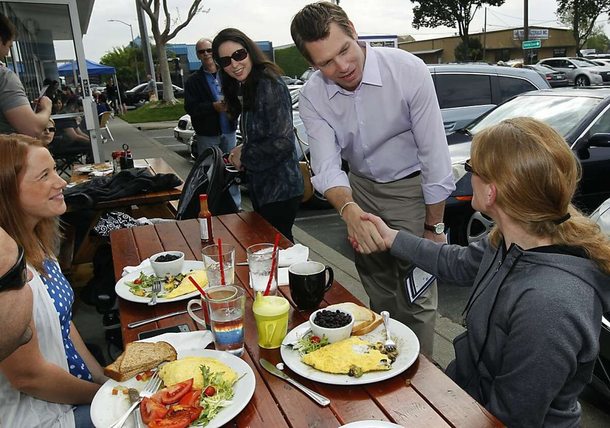 Rep. Eric Swalwell introduces himself to diners having breakfast at Denica's Pastry Cafe in Dublin, Calif. while meeting constituents of his congressional district on Saturday, March 30, 2013.