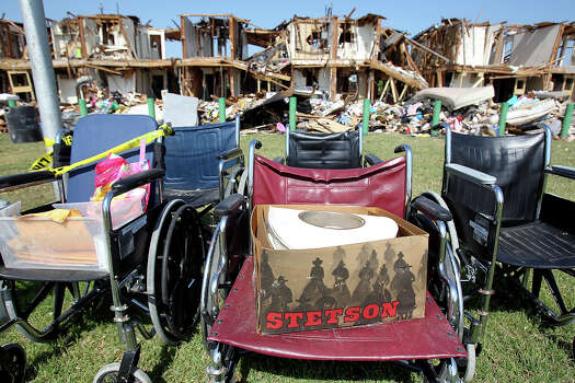 A Stetson hat rests on a wheelchair outside the apartment complex adjacent to the site of the fire and explosion in West, Texas on Wednesday, April 24, 2013. Photo: Tom Reel, Associated Press / POOL The San Antonio Express-New