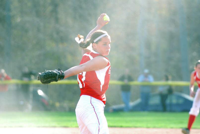 Greenwich's Alison Kach throws as Darien hosts Greenwich in a softball game in Darien, Conn., April