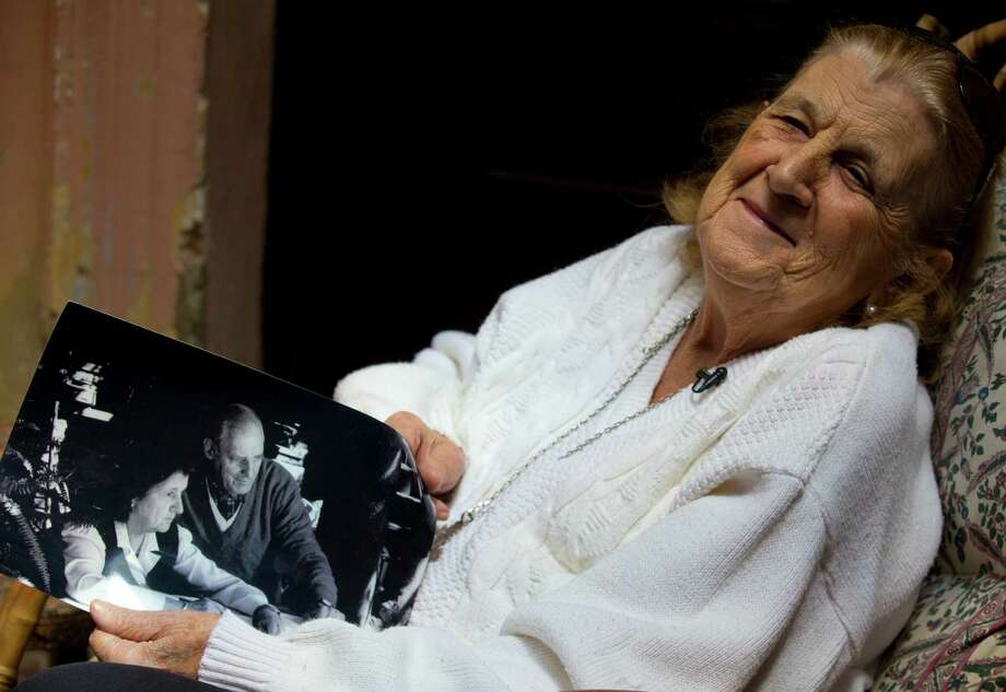 """In this April 12, 2013 photo, Clelia Luro shows a picture of herself with her late husband, Jeronimo Podesta, a former bishop of Avellaneda, at her home in Buenos Aires, Argentina. Luro, whose romance with the former bishop and eventual marriage became a major scandal in the 1960s, is such a close friend with Pope Francis that he called her every Sunday when he was Argentina's leading cardinal. She's convinced that Pope Francis will eventually lead the global church to end mandatory priestly celibacy, a requirement she says """"the world no longer understands."""" (AP Photo/Natacha Pisarenko)        In this April 12, 2013 photo, Clelia Luro shows a picture of herself with her late husband, Jeronimo Podesta, a former bishop of Avellaneda, at her home in Buenos Aires, Argentina. Luro, whose romance with the former bishop and eventual marriage became a major scandal in the 1960s, is such a close friend with Pope Francis that he called her every Sunday when he was Argentina's leading cardinal. She's convinced that Pope Francis will eventually lead the global church to end mandatory priestly celibacy, a requirement she says """"the world no longer understands."""" (AP Photo/Natacha Pisarenko) Photo: Natacha Pisarenko, STF / AP"""