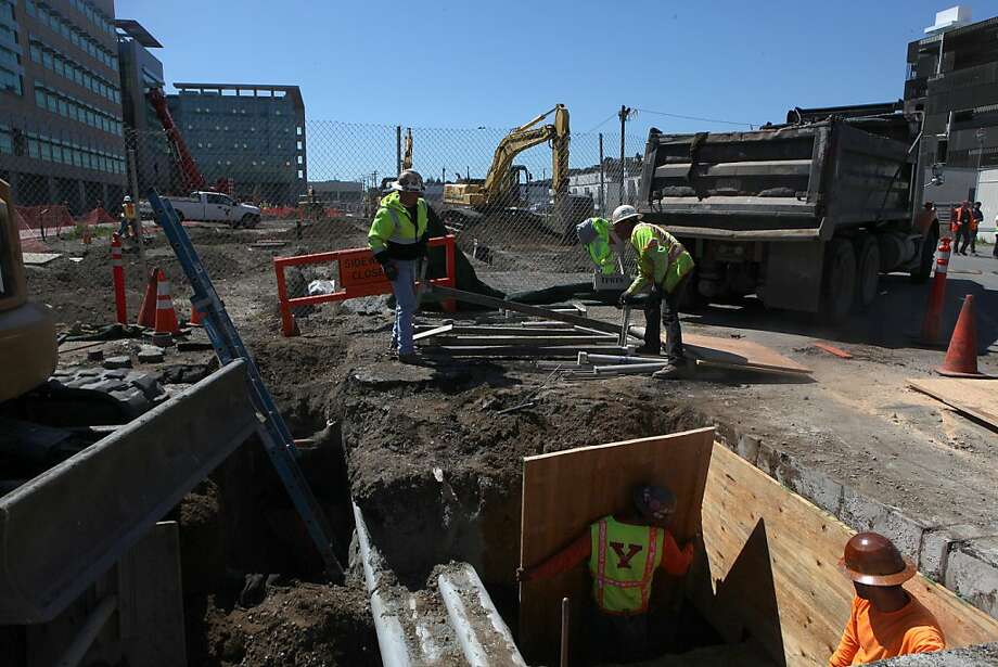 A Department of Public Works crew builds a street next to UCSF's outpatient building. The new infrastructure is needed to accommodate the university's plan to grow by more than 30 percent by 2035. Photo: Liz Hafalia, The Chronicle