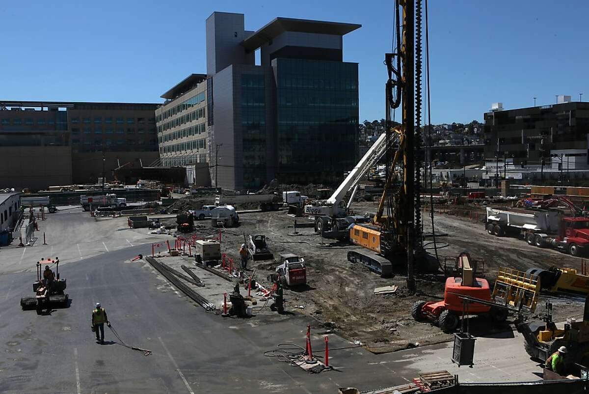 Construction on the new Global Health & Clinical Sciences Building takes place in San Francisco, California, with the new outpatient hospital seen in the background on Thursday, April 18, 2013.