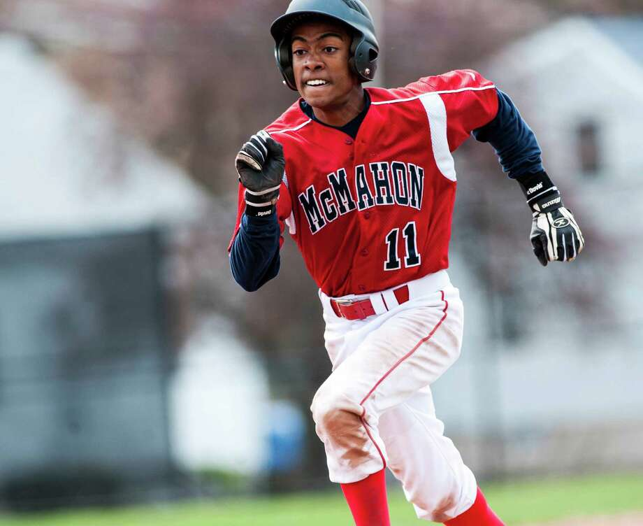 Brien McMahon high school's Edwin Owolo runs to third base during a baseball game against Stamford high school played at Stamford high school, Stamford CT on Monday April 15th, 2013 Photo: Mark Conrad / Stamford Advocate Freelance