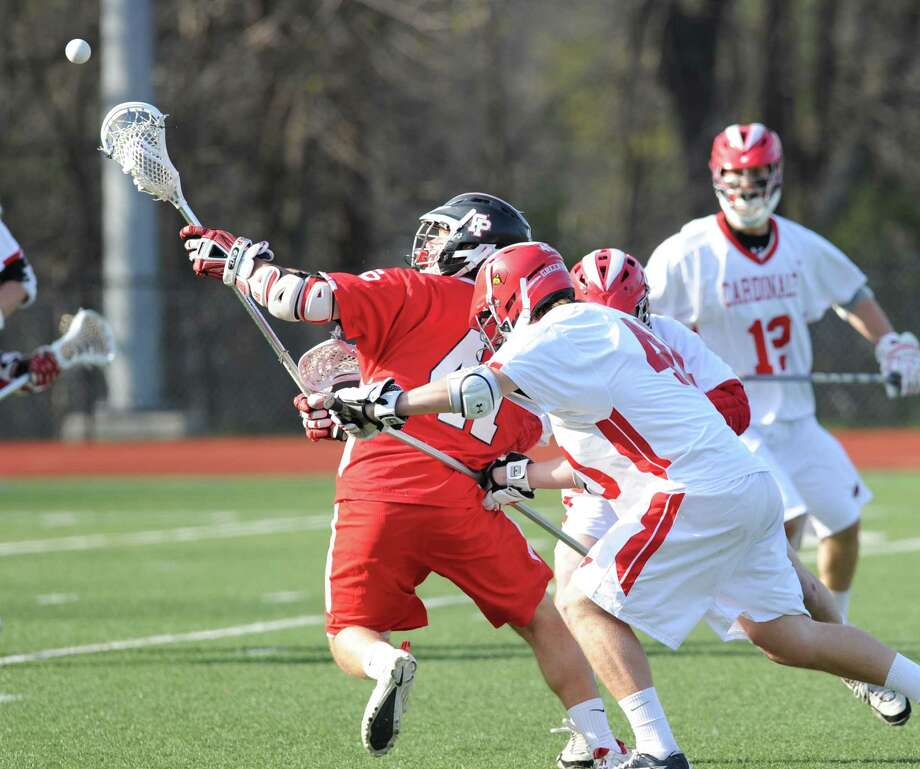 At left, Kevin Brown # 41 of Fairfield Prep goes for the ball while being defended by Griffin Tiedy # 40 of Greenwich during the boys high school lacrosse match between Greenwich High School and Fairfield Prep at Greenwich, Wednesday, April 24, 2013. At right is Jack Harrington of Greenwich.  Fairfield Prep defeated Greenwich, 7-6. Photo: Bob Luckey / Greenwich Time
