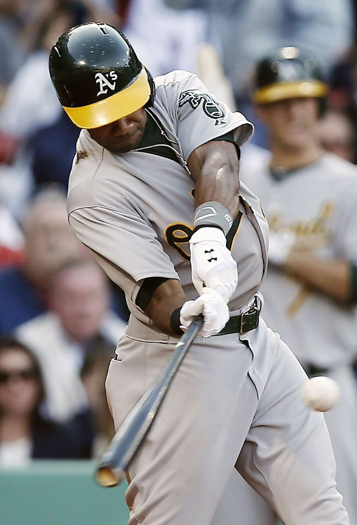 Oakland Athletics' Chris Young hits a three-run home run against the Boston Red Sox during the third inning of a baseball game at Fenway Park in Boston, Wednesday, April 24, 2013. (AP Photo/Winslow Townson)