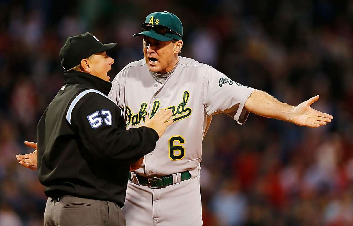 BOSTON, MA - APRIL 24: Manager Bob Melvin #6 of the Oakland Athletics argues with first base umpire Greg Gibson in the ninth inning on a foul ball call against the Boston Red Sox during the game on April 24, 2013 at Fenway Park in Boston, Massachusetts. (Photo by Jared Wickerham/Getty Images)