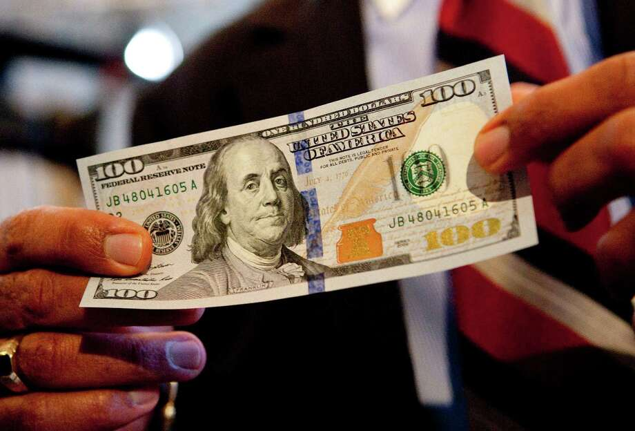 The $100 bill is the last note to undergo an extensive redesign aimed at thwarting counterfeiters. Photo: Andrew Harrer / Bloomberg News