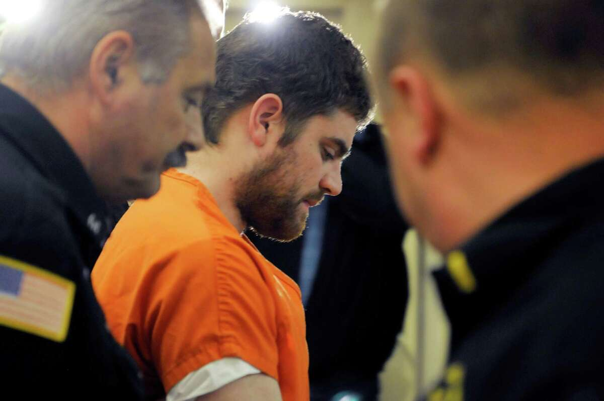 Brice Rivenburgh leaves the courtroom following his arraignment on Wednesday, April 24, 2013 at the Schenectady County courthouse in Schenectady, NY. Rivenburgh is charged in the strangulation deaths of his ex-girlfriend and her mother. POOL PHOTO (Paul Buckowski / Times Union)