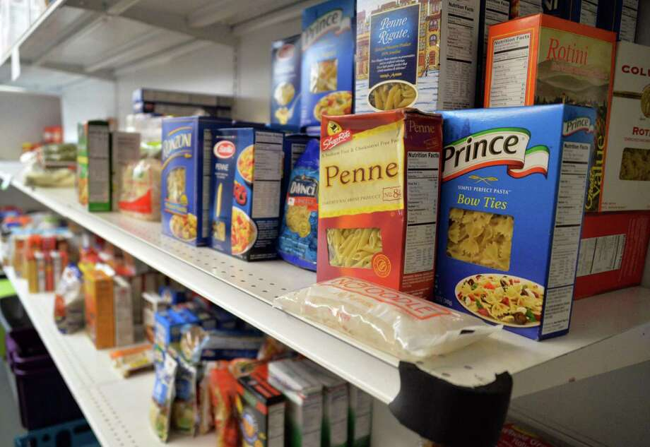 Shelves of food at the Wilton Food Pantry in Wilton,NY Friday April 19, 2013.  (John Carl D'Annibale / Times Union) Photo: John Carl D'Annibale / 00022048A