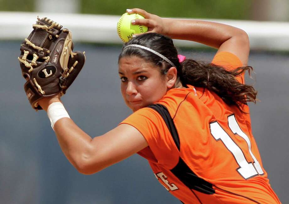 5/7/2011:   Tori Vidales #11 of La Porte fields the ball in the fourth inning against  Brazoswood in the second round of the Class 5A softball playoffs at Brazoswood. Brazoswood won 11 to 3. Thomas B. Shea : For the Chronicle. Photo: Thomas B. Shea, Freelance / Thomas B. Shea : For the Chronicle