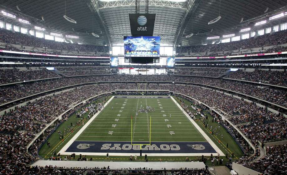 Big 12 coaches, particularly those in the Lone Star State, are ecstatic the inaugural College Football Playoff title game in 2014 will be contested at Cowboys Stadium. Photo: Sharon Ellman / Associated Press