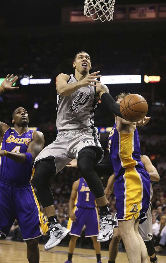 San Antonio Spurs' Danny Green drives between Los Angeles Lakers' Antawn Jamison and Pau Gasol in the first half of game 2 in the first round of the NBA Playoff at the AT&T Center, Wednesday, April 24, 2013.