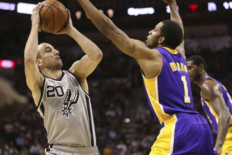 San Antonio Spurs' Manu Ginobili shoots over Los Angeles Lakers' Darius Morris in the first half of game 2 in the first round of the NBA Playoff at the AT&T Center, Wednesday, April 24, 2013.