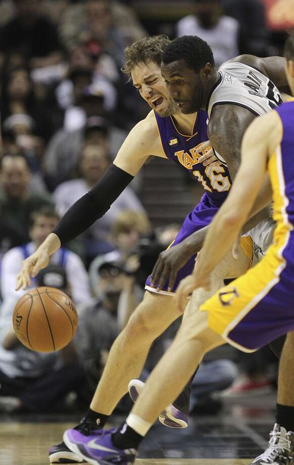 San Antonio Spurs' DeJuan Blair goes for a loose ball against Los Angeles Lakers' Pau Gasol in the first half of game 2 in the first round of the NBA Playoff at the AT&T Center, Wednesday, April 24, 2013.