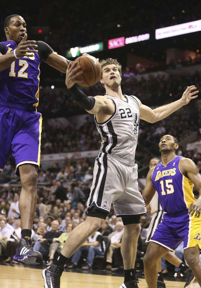 San Antonio Spurs' Tiago Splitter gets the rebound against Los Angeles Lakers' Dwight Howard in the first half of game 2 in the first round of the NBA Playoff at the AT&T Center, Wednesday, April 24, 2013. Jerry Lara